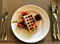Belgian Waffle with Choice of Topping, Whipped Cream Strawberries, Eucalyptus Honey, Banana or Chocolate Sauce