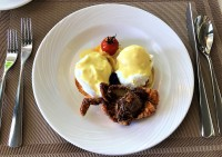Maldivian Style Eggs Benedict - English Muffins Topped with Marinated Sliced Yellowfin Tuna, Hollandaise Infused Coconut Curry, Soft-Shell Crab Tempura